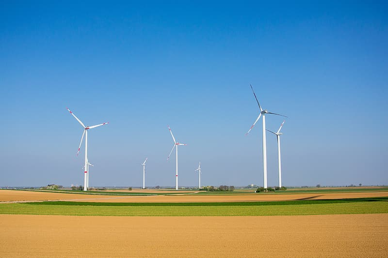 White turbines on green field