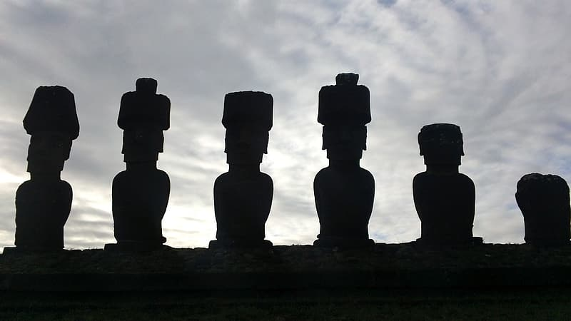 Silhouette of six statues