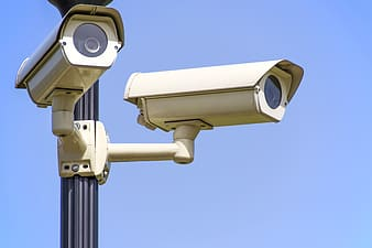 Two white surveillance cameras