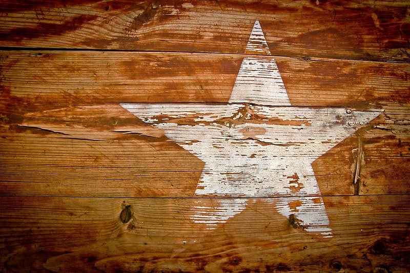 White star painted on brown wall
