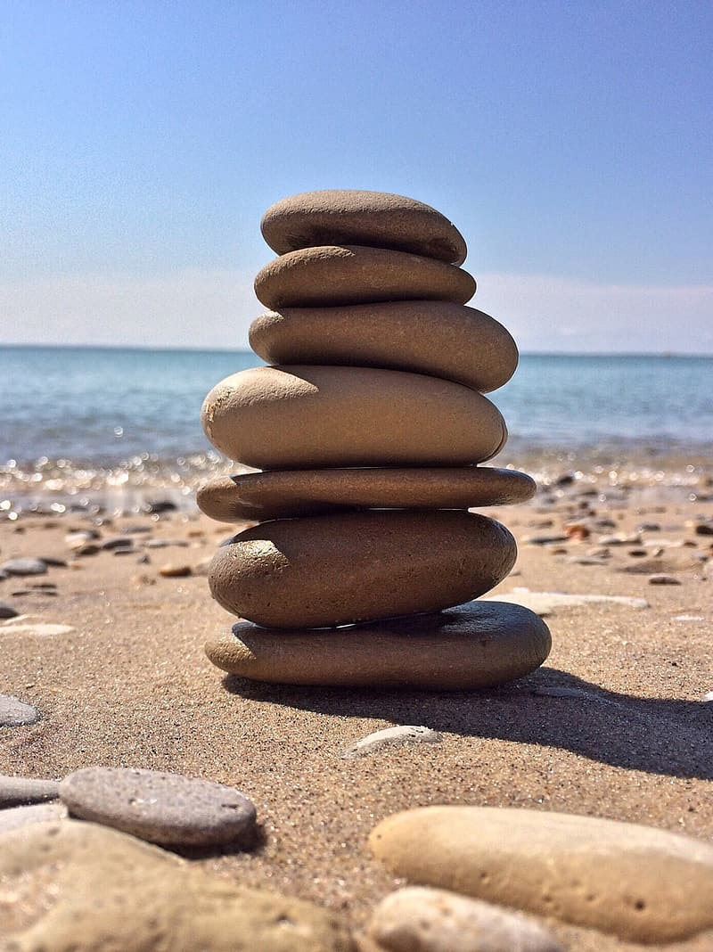 Brown stone stack on beach during daytime