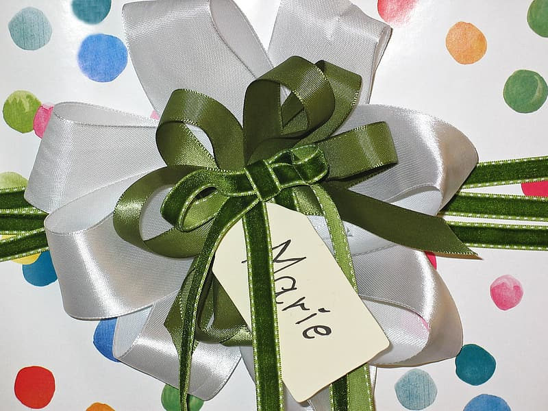 Green and white ribbon tied gift