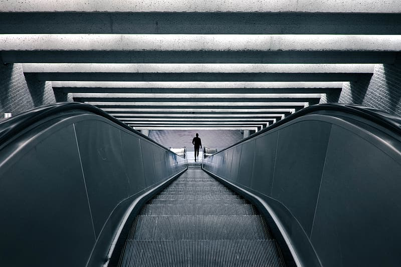 Person walking on black tunnel