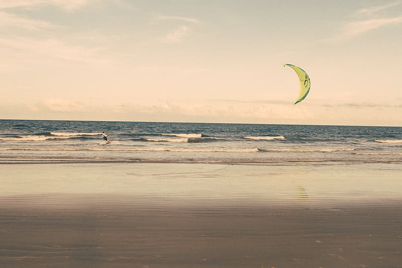 Person parasailing during day time