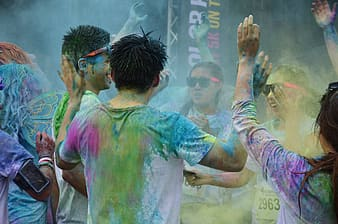 Group of people covered with paint and celebrating