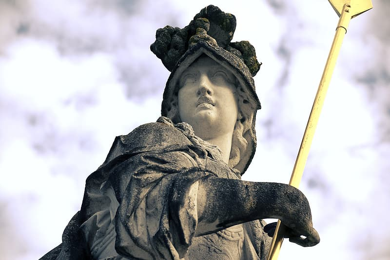 Man in black and brown hat statue
