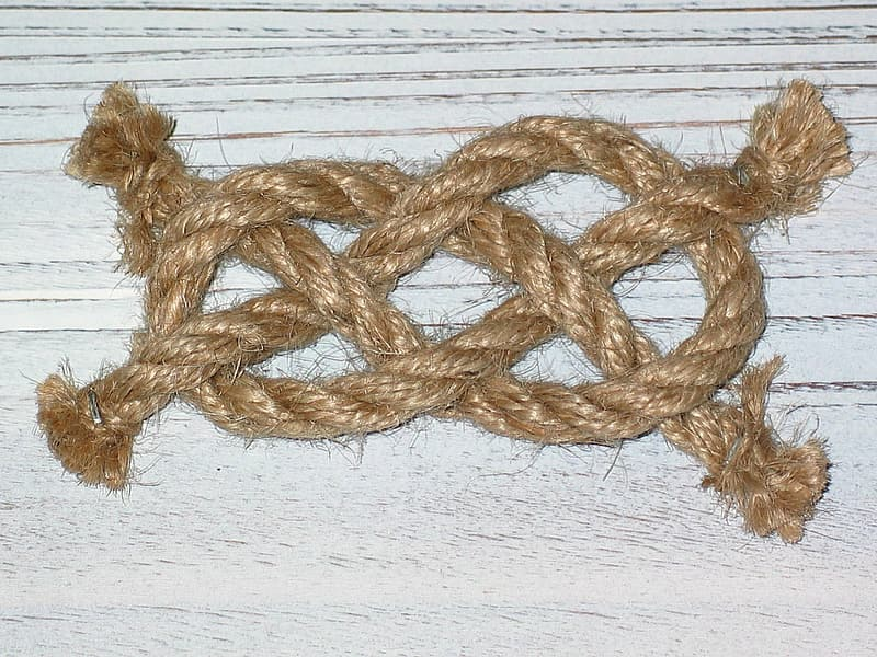 Brown rope on white surface