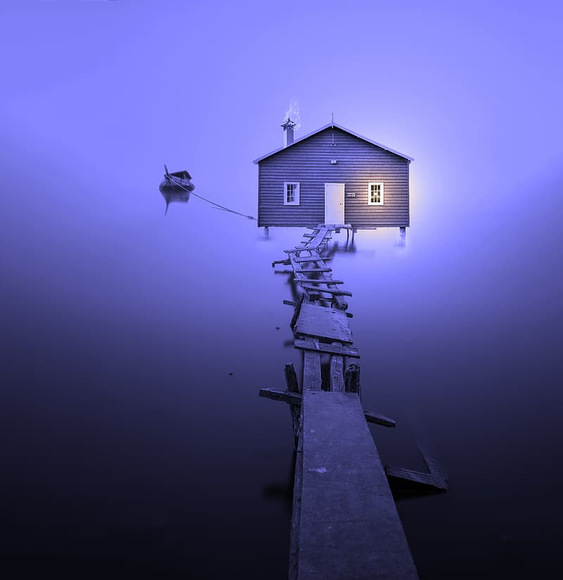 Brown wooden house with wooden dock under purple sky