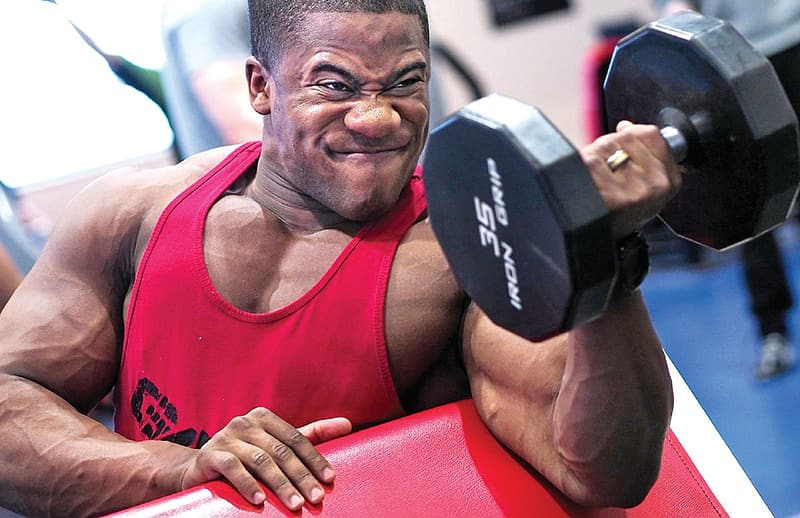 Man holding 35 Lbs dumbbell