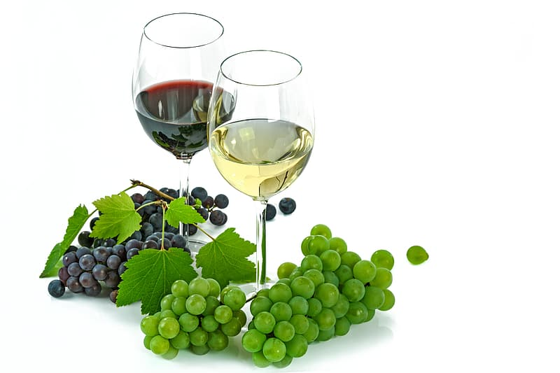 Two wine glasses surrounded by grapes