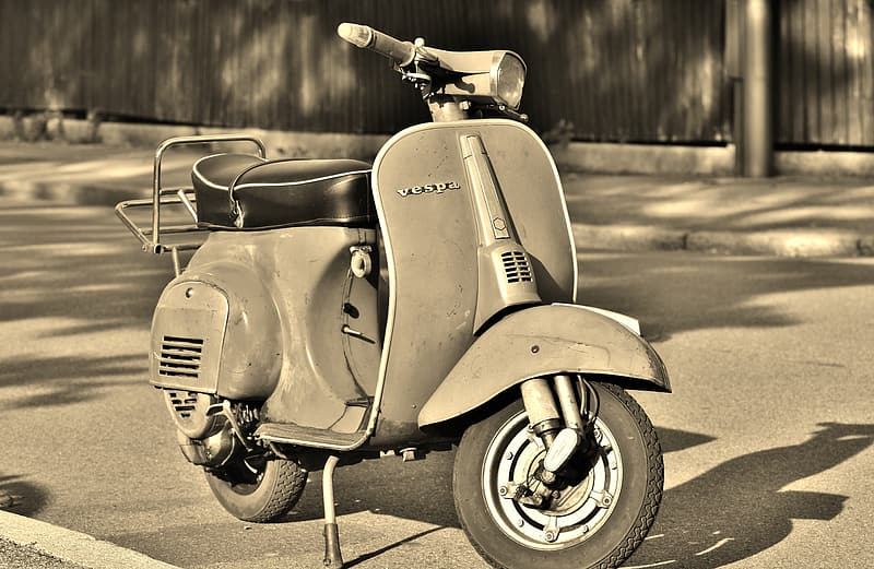Grayscale photo of motorcycle on road