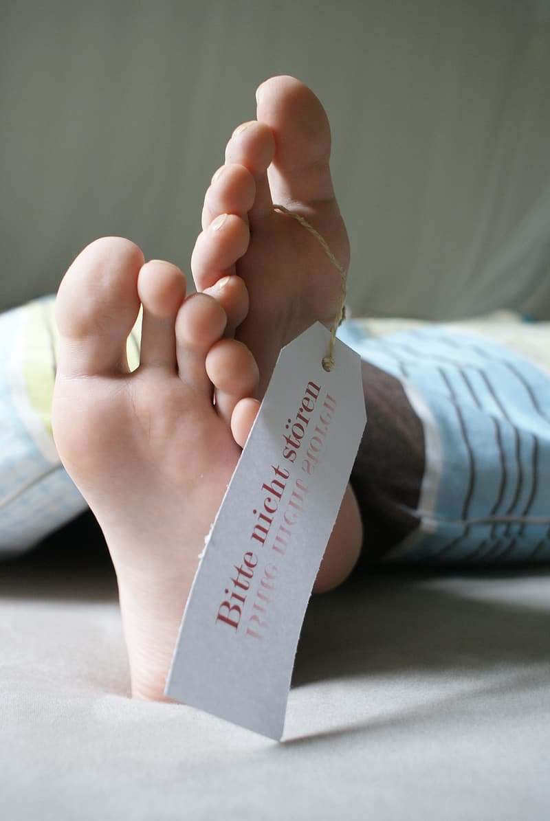 Person feet with tag