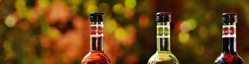 Selective focus photography if three glass bottles