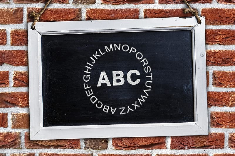 Alphabet letters on blackboard with white frame