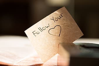 Closeup photo of follow your heart printing paper