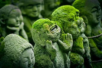 Human concrete statue with moss