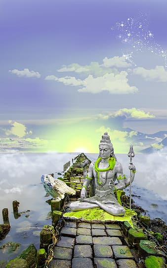 Green and gray statue under white clouds and blue sky during daytime
