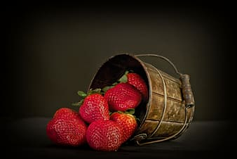 Strawberry on brown bucket
