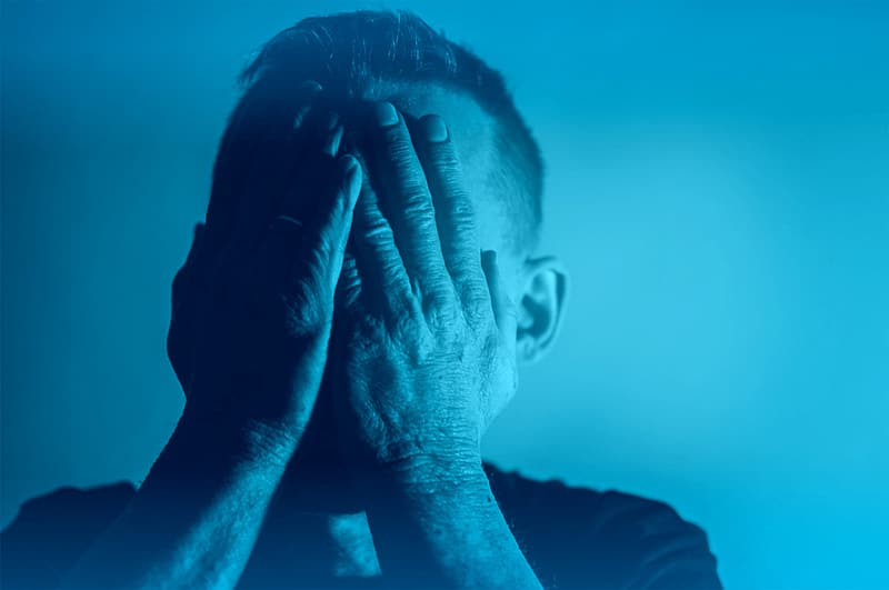 Depression - Sadness - Despair - Man with Hands Covering Face - Blue Tone