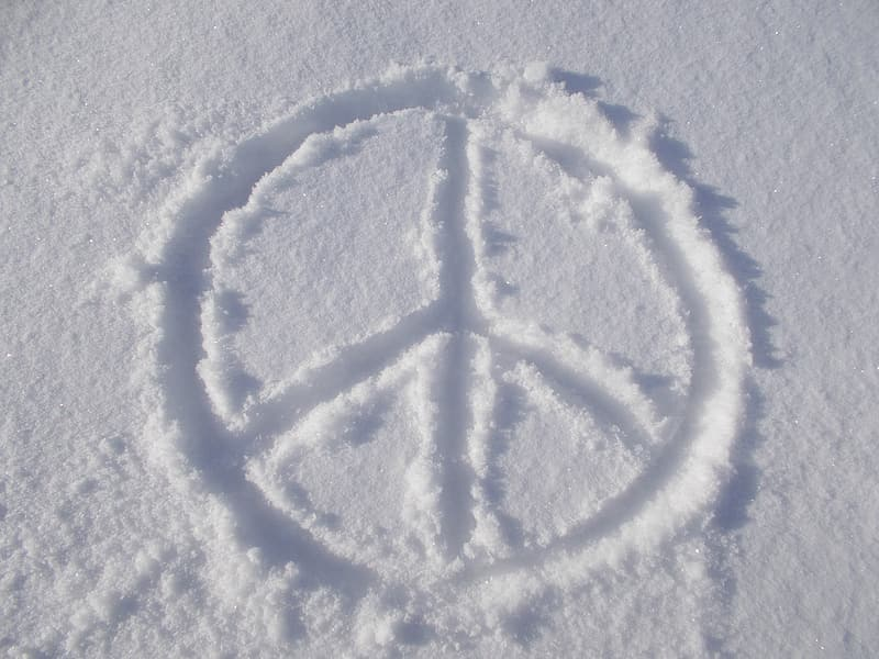 Peace symbol on snow during daytime