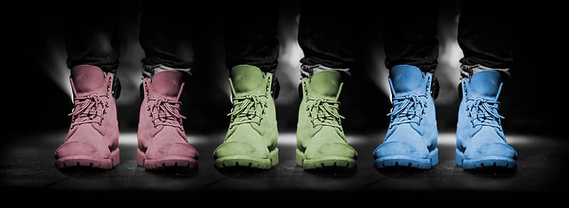 Three pairs of pink, green, and blue lace-up high-top shoes