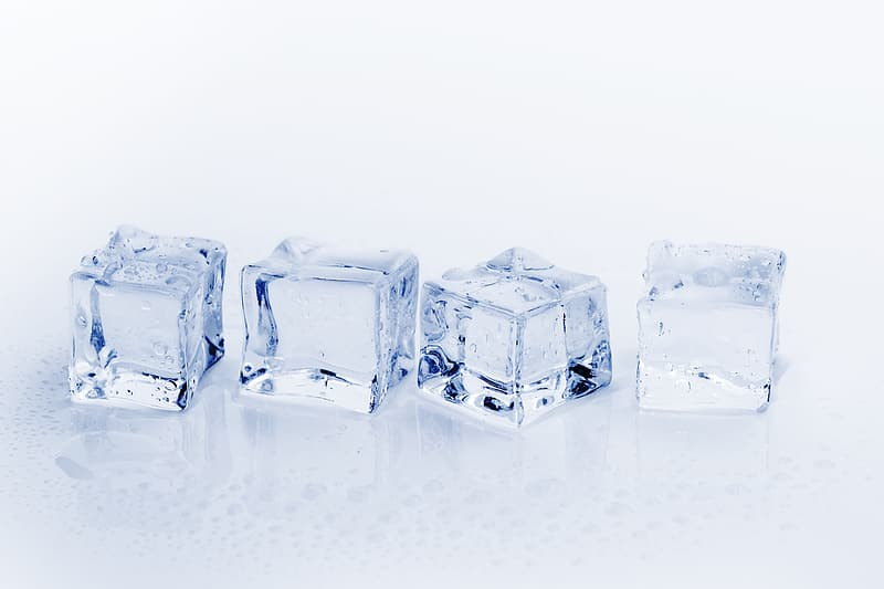 Four ice cube on white surface