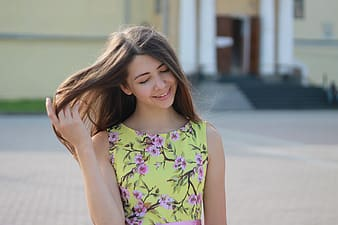 Woman wearing yellow and pink floral dress
