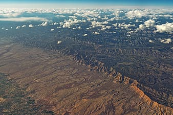 Aerial view of brown and black mountains during daytime