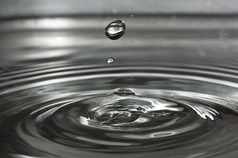 Water droplet creating ripple
