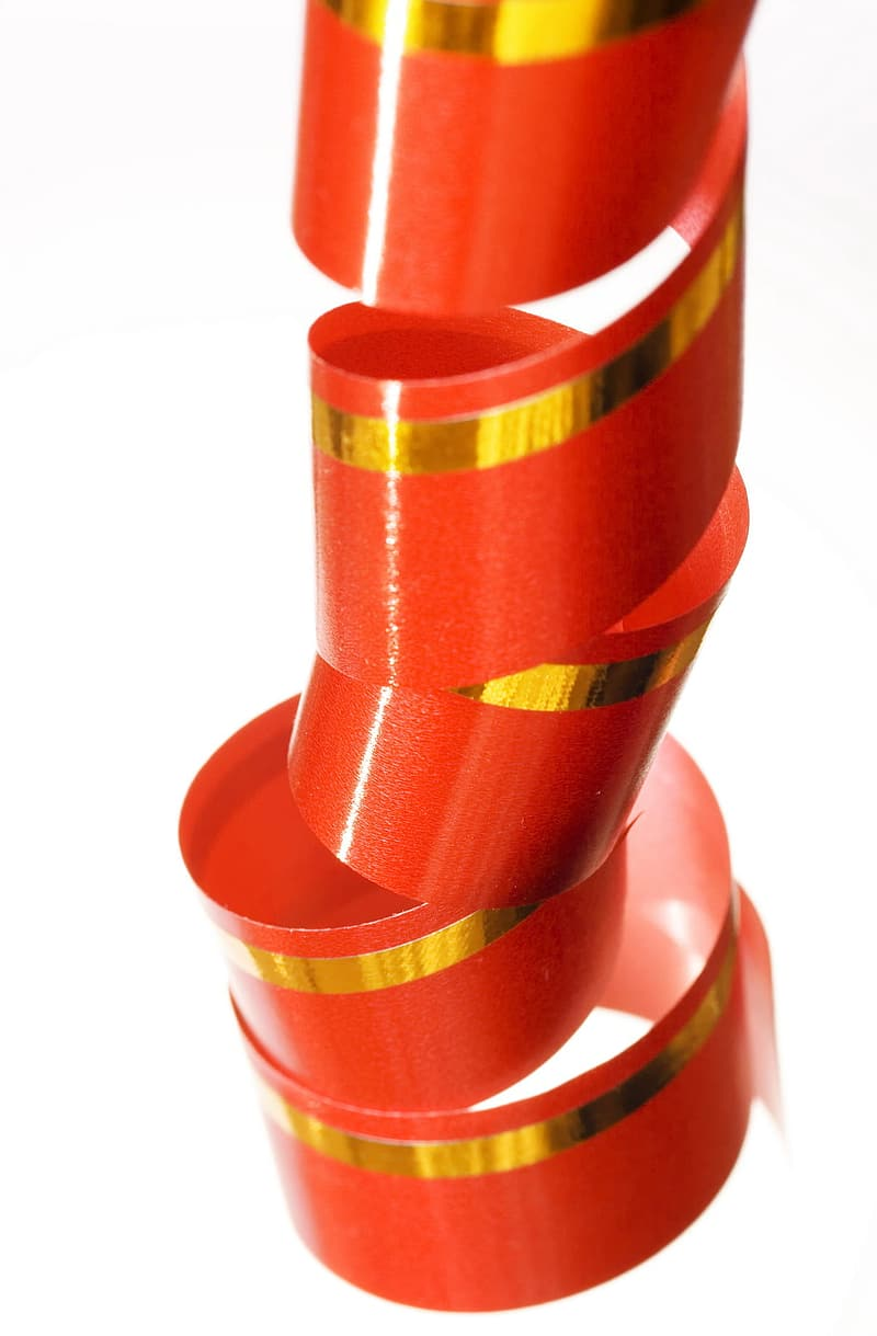 Red and yellow ribbon on white background