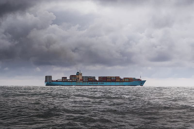 Photo of blue cargo ship in body of water during daytime