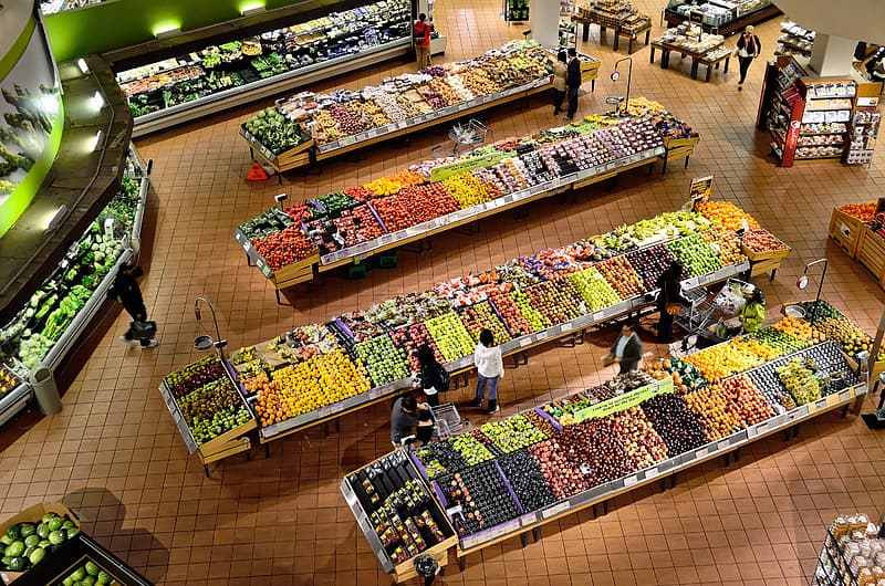 Aerial view of people buying fruits display