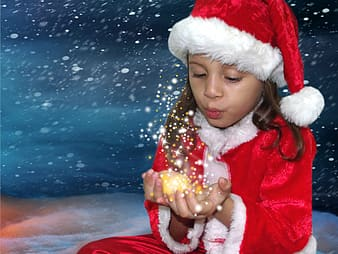 Girl in red and white santa hat and red jacket