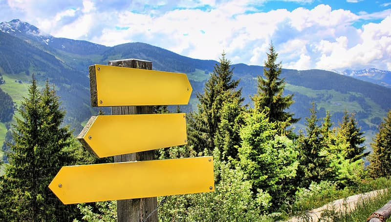 Yellow wooden arrow signage