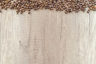 Flat lay photography of coffee beans on wooden surface