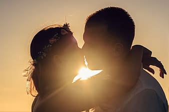 Man and woman about to kiss