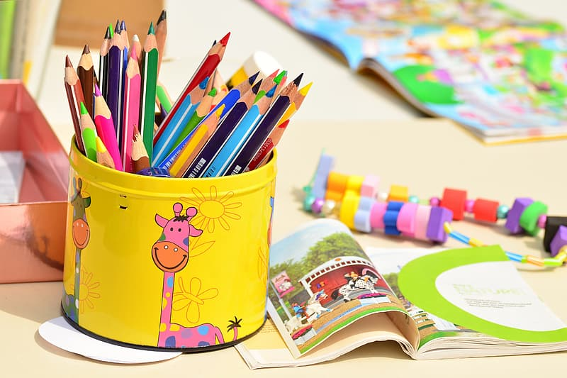 Photo of coloring pencils on yellow container