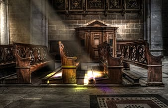 Brown wooden pew with sun rays close-up photography