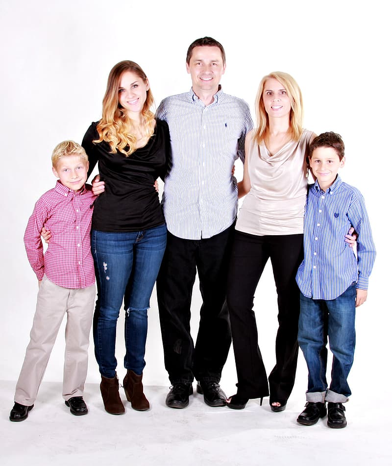 Photo of two women, two boys, and man
