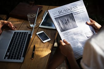 Person holding Business newspaper
