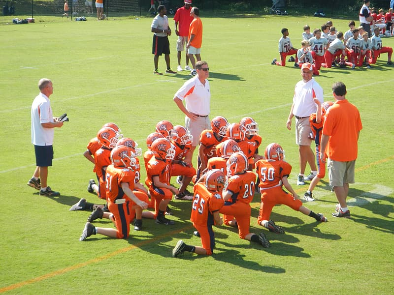 Football team on field during daytime