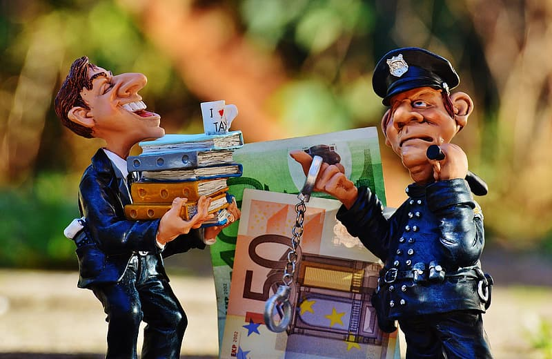 Two blue-and-beige ceramic officeman and policeman figurines selective focal photo