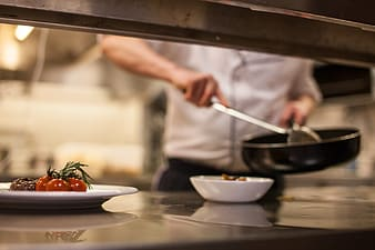 Shallow focus photography of chef