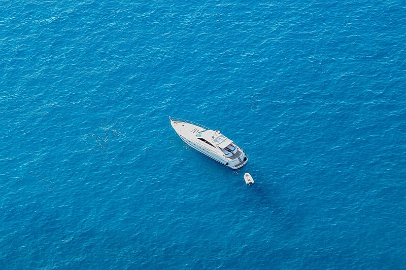 White yacht in the middle of body of water