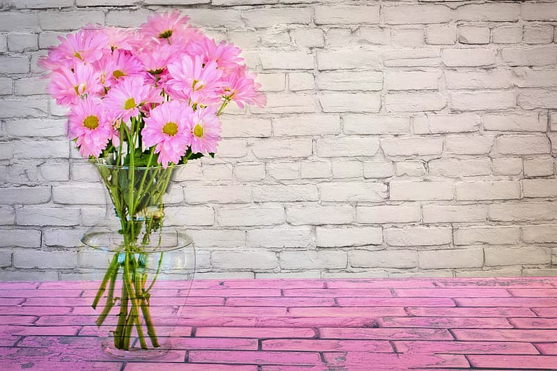 Clear glass vase with pink flowers