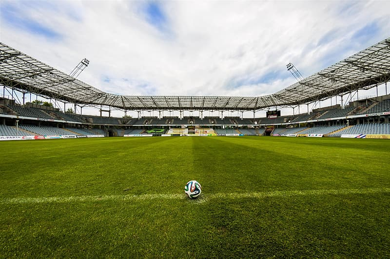 Soccer field with ball on empty field