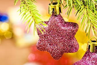 Silver and gold bell on purple christmas tree