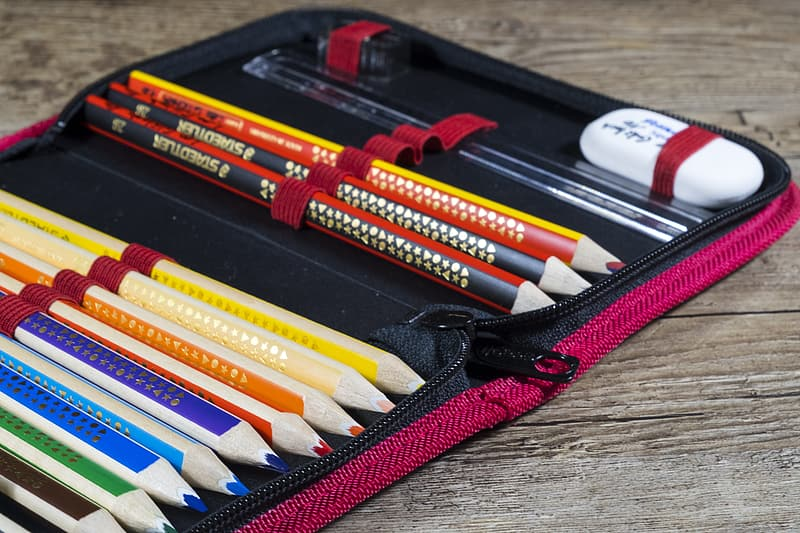 Assorted-color pencils with eraser on pouch