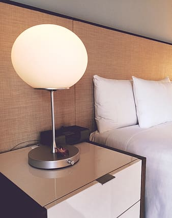 White and gray table lamp on white end table