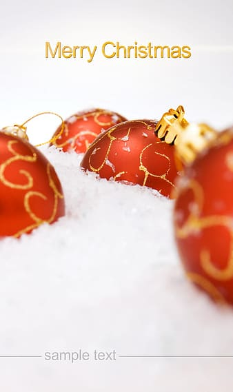 Red and gold baubles on white snow